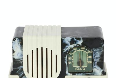 "Addison model A2 ""Baby"" Bakelite radio, Canadian, 1940s, with a marbled black case with white Plaskon trim, sold for more than five times its high estimate CA$4,425)."