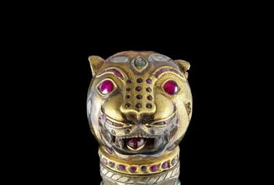 A rare gem-set sword with tiger's head pommel from Tipu Sultan's royal regalia.  Estimated at £60,000-80,000 it was sold for £2,154,500