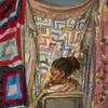 Sedrick Huckaby, She Wore Her Family's Quilt, 2015, oil on canvas.  Photograph by Gregory Staley.