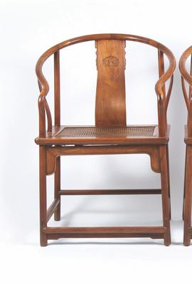 An exceedingly rare pair of Chinese Huanghuali Continuous Horseshoeback Armchairs dating from the early Qing Dynasty