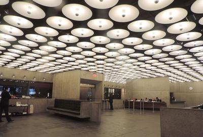 The renovated lobby of the Met Breuer building, which had been designed by Marcel Breuer, and will be used by the Frick in 2021.