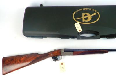 Chapuis Armes (France) Juxtapose Progress shotgun, 20 gauge, 2-shot side-by-side, ornately engraved and with special markings 'WLM & Co.  Scottsdale AC' stamped underside of barrel.  Comes with Chapuis Armes France fitted hard-side carry case.  Estimate $4,000-$7,000
