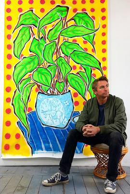 "British artist Jonjo Elliott with his painting ""Arms Raised in a V"""