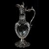 ABCG pedestal ewer, with reticulated sterling silver foot with embossed spout, handle and flip lid by Theodore Starr Co., 14 inches tall, engraved with a fern design, star diamond and fan highlights.