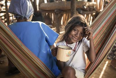 Areleonis Ipuana, 7, drinks clean water at her house in Kasichi, Maicao, La Guajira, Colombia.  March 2017.  Credit: WaterAid/ Jordi Ruiz Cirera