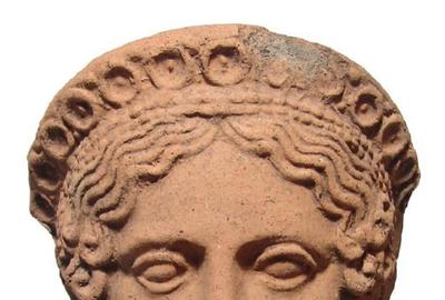 Gorgeous 10-inch-tall Etruscan terracotta female votive head from the 4th Century BC, with beautifully modeled features in high relief, last purchased thru Sotheby's (est.  $5,000-$7,000).