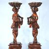 Museum-worthy, Renaissance Revival double carved putti on carved pedestals, designed and carved by a true master in the mid-19th century, 74 inches tall (est.  $20,000-$35,000).