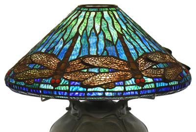 "A top lot was a circa 1905-10 Tiffany Studios ""Dragonfly"" table lamp having a ""Pepper"" base and measuring 18 inches tall that fetched $87,725"