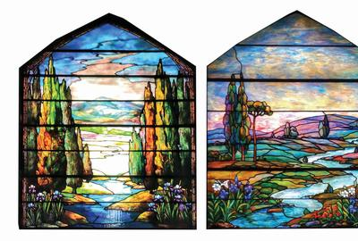 Lot of two leaded-glass windows attributed to Tiffany Studios.  Window at left shows poplar trees bordering a stream, while window at right, measuring 41 x 80in., features rolling hills and meadows, and is similar to an example in Alastair Duncan's book 'Tiffany Windows.' Lot estimate $100,000-$250,000