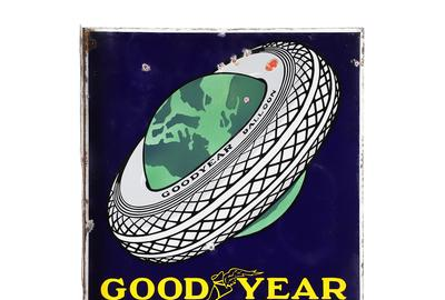 "Circa 1930s Canadian Good Year Tires double-sided porcelain flange sign, featuring Good Year's ""tire around the world"" graphic, 27 ¾ inches by 20 inches (est.  CA$6,000-$8,000)."