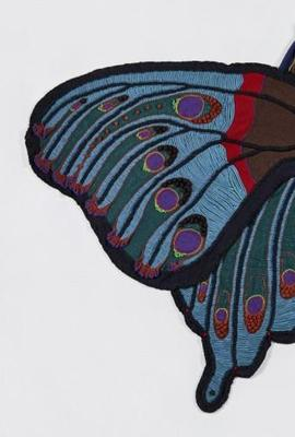 """Moth Cape,"" 1979, by Susanna Lewis.  Loom-knitted, appliqued wool; beads, 69 × 107 inches.  Promised gift of The Julie Schafler Dale Collection.  Image courtesy Philadelphia Museum of Art, 2019."