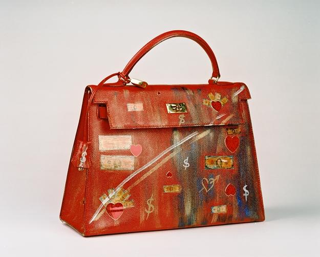 "Copyrights Antonia Pia Gordon, Series Money & Love, The Irresistible Never Ending Search For True Love, Kelly Bag, ""He is in the Bag"", Acrylics on Leather, 23,5x32,7x12,5 cm"