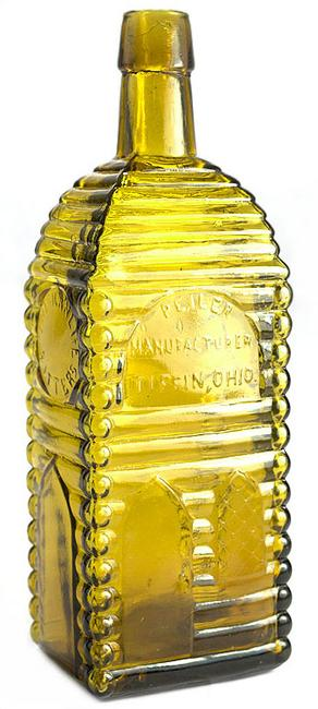The auction's top lot was this American Life Bitters bottle (P.E.  Iler, Mfg., Tiffin, Ohio), circa 1865-1875, 9 ¼ inches tall, in a light to medium yellow color with an olive tone cabin ($42,000).