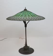 "Leading the auction was this Tiffany Studios ""Lotus"" table lamp at $150,000, signed, 14 inches tall."