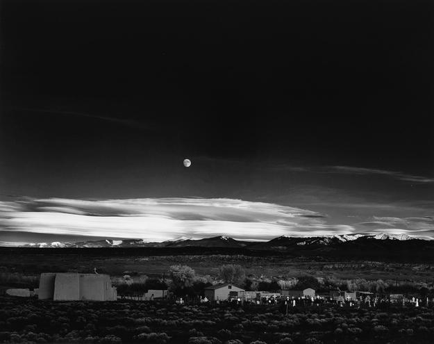 Lot 103: Ansel Adams, Moonrise, Hernandez, New Mexico, silver print, 1941, printed circa 1965.  Estimate $80,000 to $120,000.