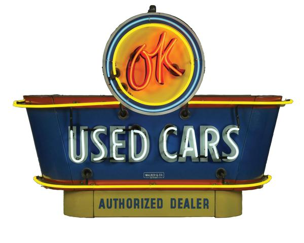 Outstanding OK Used Cars double-sided neon porcelain dealership sign with original bullnose attachments, 56 x 40 x 18in.  Estimate $14,000-$20,000