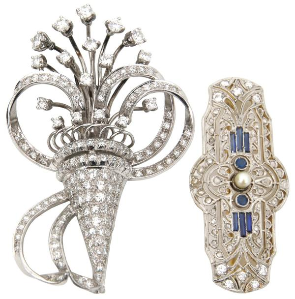 These two platinum, gold and diamond brooches ($1/1,500) will cross the block.