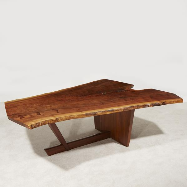 GEORGE NAKASHIMA (AMERICAN, 1905-1990) THE IMPORTANT HOLTZ DINING TABLE, NEW HOPE, PENNSYLVANIA, 1986 Claro Walnut, American Black Walnut, rosewood.  H: 29, L: 92, W: 65 in.  Estimate $150,000-250,000