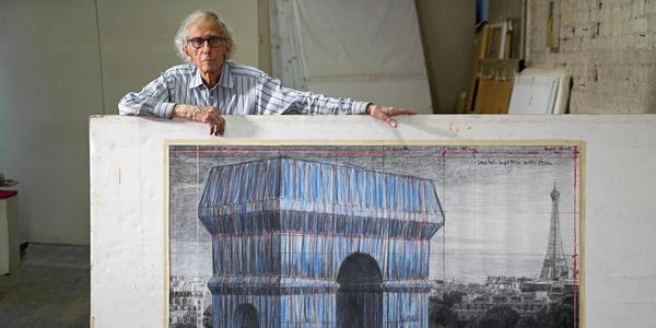 """Christo in his studio with a preparatory drawing for """"L'Arc de Triomphe, Wrapped."""" New York City, September 20, 2019.  Photo: Wolfgang Volz © 2019 Christo and Jeanne-Claude Foundation"""