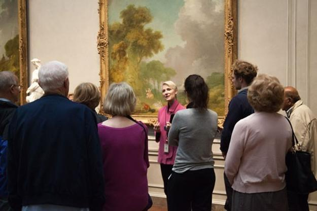 A Gallery docent leads a group tour in a discussion of Jean-Honoré Fragonard's The Swing, c.  1775/1780, National Gallery of Art, Washington, Samuel H.  Kress Collection.
