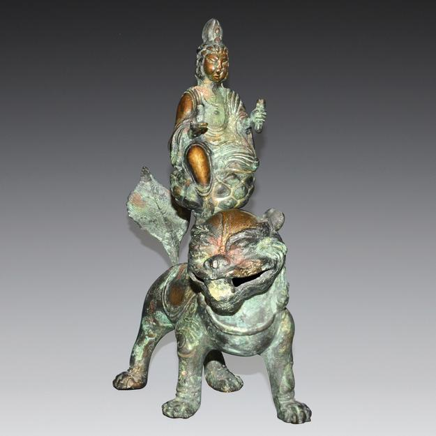 "Bronze Bodhisattva Manjushri riding on the back of a Buddhist lion.  10"" tall.  Weight, 4 pounds.  Lot 153.  Gianguan Auctions, June 10, 2017."