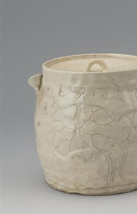 • Otagaki Rengetsu (1791-1875): A large moon white mizusashi (water container) by Rengetsu with an imprinted lotus leaf enhancing an amusing play of words, since that Rengetsu translates to Lotus Moon.  (#1691)