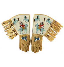 Turn-of-the-century Native American (Plateau) gauntlets, fully beaded with images of multiple figures, including Indian chiefs and horses.  Cuffs adorned with long fringe.  Estimate $4,500-$7,500