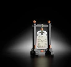 Cartier.  A very fine diamond-set jade, onyx, coral, beryl and gold Chinoiserie desk clock (estimate: $40,000 - 60,000)
