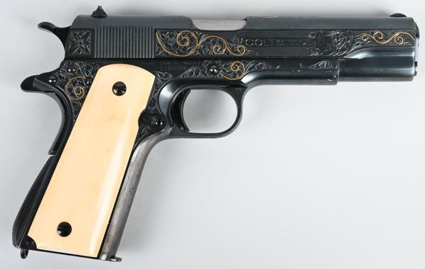Gold-inlaid Colt 1911 .45 ACP-caliber gun, factory-engraved by Colt master engraver William H.  Gough (active 1912-1940).  Shipped in 1931 to Scruggs, Vendervoort & Barney, St.  Louis.  Sold for $51,600 against an estimate of $25,000-$35,000