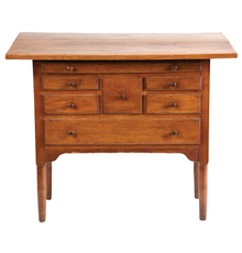 Circa-1840 Shaker dropleaf sewing table composed of butternut, cherry, pine and possibly basswood.  Probably from the Shaker community of Hancock, Massachusetts; attributed to family elder David Terry.  Attracted 69 bids and sold for $98,400 against an estimate of $5,000-$10,000