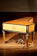 Austrian Ormolu-Mounted Parcel Ebonized and Gilt Gesso Elmwood Piano Forte (estimate: $10,000-$15,000)