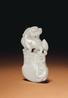 A Fine White Jade Axe-Form Pendant, 18th/19th Century Estimate: $10,000-15,000