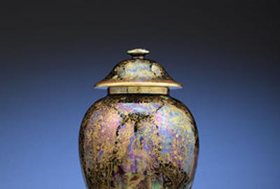 "Deep blue, violet and emerald hues shimmer in this magnificent ginger jar in the ""Jewelled Tree"" pattern with ""Cat and Mouse and Copper Trees"" panels"