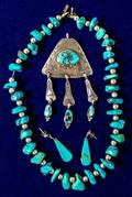 Beautiful turquoise and silver necklace, pendant and earrings, with vintage pawn sterling beads.