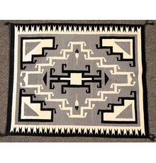 Exquisite Toadlena Two Grey Hills (New Mexico) weaving, 42 inches by 36 inches, in excellent condition, with the four corners hooked, as is the center diamond (est.  $1,500-$3,000).