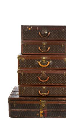Various Louis Vuitton trunks available at auction on April 21-22 at Leslie Hindman Auctioneers.