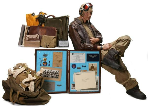 Important 75-piece archive of personal and service items belonging to Tuskegee Airman William S.  Powell Jr.  Uniform includes A-2 leather jacket with squadron patch and name, flight suit and other apparel with all insignia, parachute, kit bag, flight log, many documents including Tuskegee diploma with signatures of classmates and instructors.  Estimate $40,000-$60,000