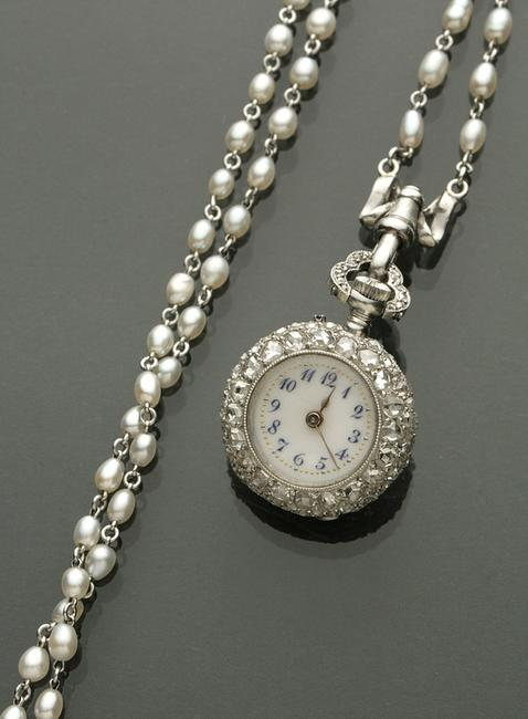 An Edwardian lady's platinum, diamond and seed pearl pendant watch by Vacheron & Constantin took center stage and sold to a phone bidder for $28,200.
