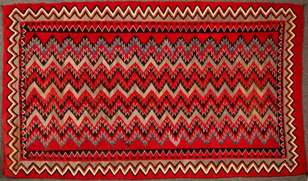 Stunning example of a Navajo Red Mesa Native American rug, near perfect condition, 5 feet by 8 feet 5 inches, with dramatic, exotic colors inspired by Hispanic weavings (est.  $5,000-$8,000).