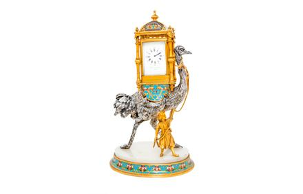 A French Gilt and Silvered Bronze and Champleve Figural Clock, $2,000 - 4,000