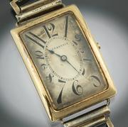"A Gentleman's Patek Philippe 18K Gold Rectangular Curved Wristwatch With ""Explosion"" Numerals, Very Fine and Rare, Manufactured for Tiffany & Co, ca.  1918"