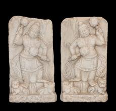 Chinese marble stelae, with high relief guardians clenching clubs and trampling beastly demons.  Lot 75, Gianguan Auctions, December 9, 2017