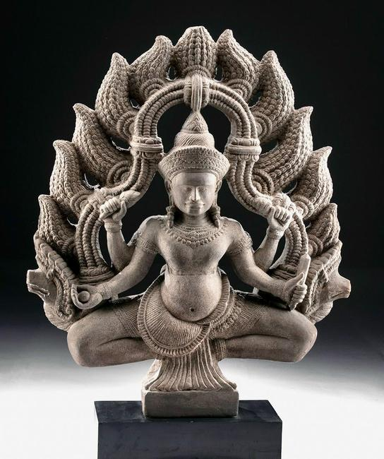 Superb 8th-12th century Khmer (Cambodia, Angkor culture) stone statue of Hindu god Shiva, buff grey sandstone, 30in high.  Estimate $16,000-$24,000