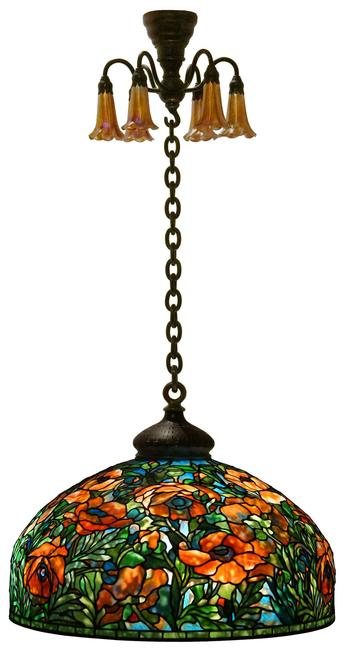 Expected to lead the auction is this 1902-signed Tiffany Studios Oriental Poppy chandelier ($400/600,000) having a leaded glass shade decorated with red-orange Oriental poppy flowers rising out of green stems, set against a blue background, 50 by 26 inches.