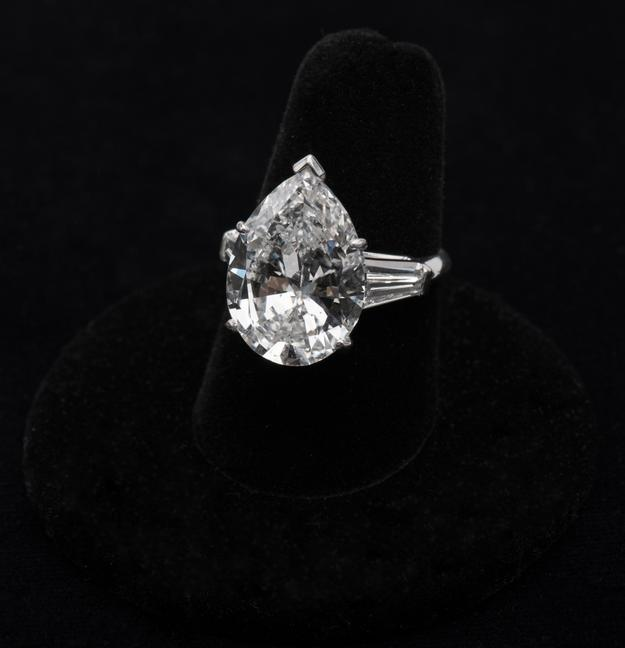 Lot 134: GIA certified 9.19 cts.  pear-shape diamond ring.  Est.  $75,000-100,000