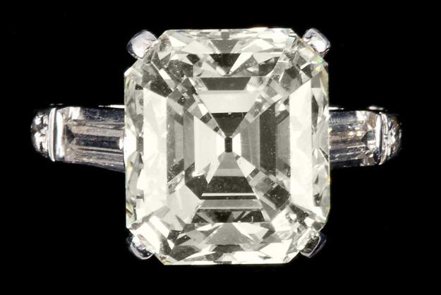 Impressive 9.90 carat Platinum and Diamond Ring, centering on one emerald cut diamond (est.  $80,000-$100,000)