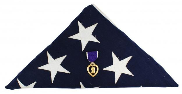 This Purple Heart, awarded to U.S.  Cpl.  Joseph E.  Oleskiewicz for valor shown on June 6, 1944 in Normandy, France, sold for $5,100 at the Dec.  5-6 auction.
