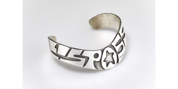 """All Is Possible"" sterling silver cuff with star.  From the collection of Suijin Li Snyder.  Photo by Jason Dowdle."