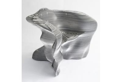 "Mathias Bengtsson Danish, b.  1971 ""Slice"" chair, designed 1999 Aluminum; 29 1/2 x 35 x 29 in.  Milwaukee Art Museum, Gift of Friends of Art, M2011.11 Photo Courtesy of Industry Gallery"