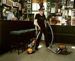 Amelia Troubridge, Michael Wojas hoovering at The Colony Rooms, 2008, Giclée digital archival print, 16 x 12 in.  © Amelia Troubridge.  Courtesy of Dellasposa Gallery
